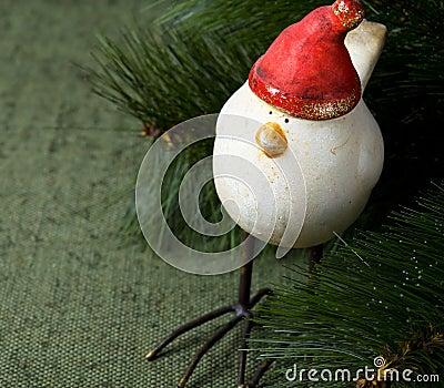 Funny santa bird on the green with xmas tree