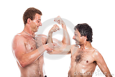 Funny shirtless men compare muscles