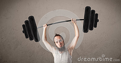 Funny skinny guy lifting weights Stock Photo