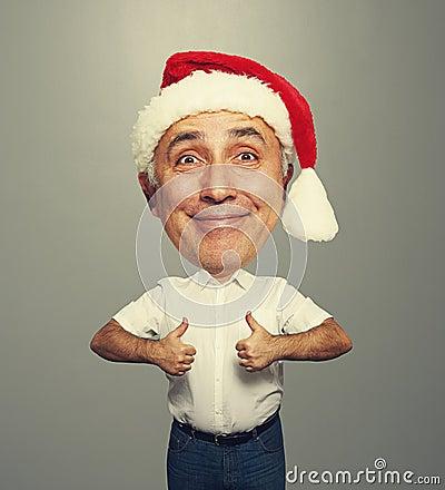 Funny smiley senior man in red santa hat