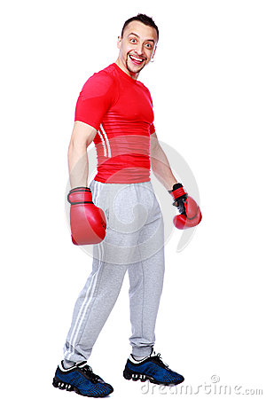Funny sportsman in boxing gloves standing