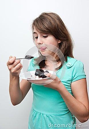 Funny teen girl eating charlotte isolated on white