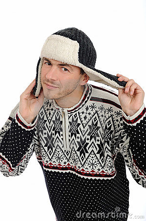 Funny winter man in warm hat and clothes listening