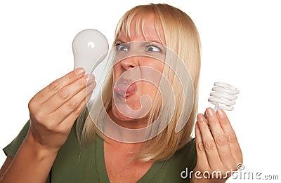 Funny Woman Holding Energy Saving & Regular Bulbs