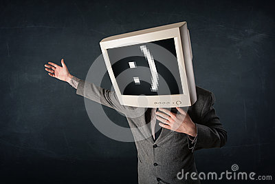 Funny young businessman with a monitor on his head and smiley on Stock Photo