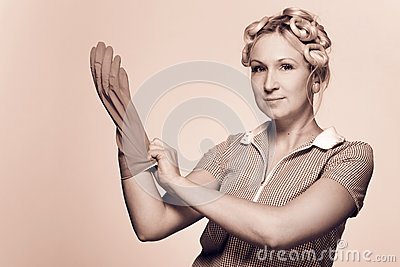Funny young housewife with gloves