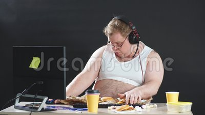 Funny young man in headset with pc computer playing game at home. Technology concept. Funny young man in headset with pc computer playing game at home stock footage