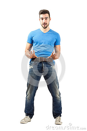 Free Funny Young Man Pulling His Belt Stock Image - 47190321