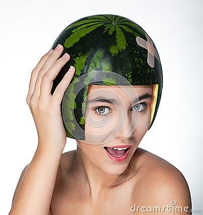 Funny young pretty female in helmet - fresh melon