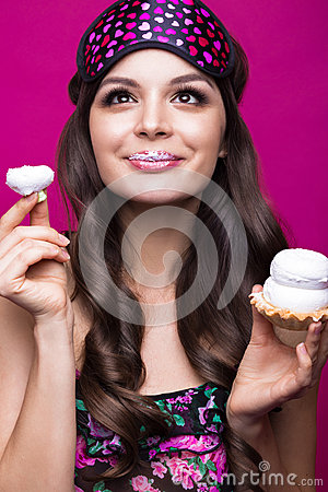 Free Funny Young Woman In Sleeping Mask And Pajamas, Sweets On Pink Background. Beauty Face. Stock Image - 74801841
