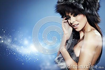 Fur Fashion. Beautiful Girl in Fur Hat.