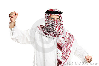 A furious arab man with covered face protesting