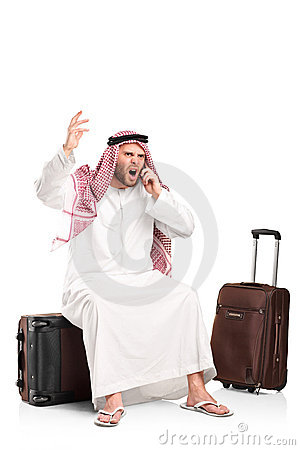 Furious arab shouting on a mobile phone