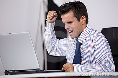 Furious businessman at his office