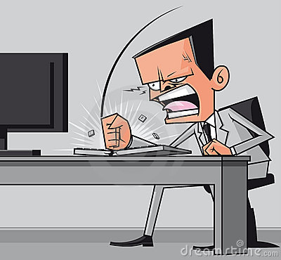 Furious businessman hitting the computer keyboard