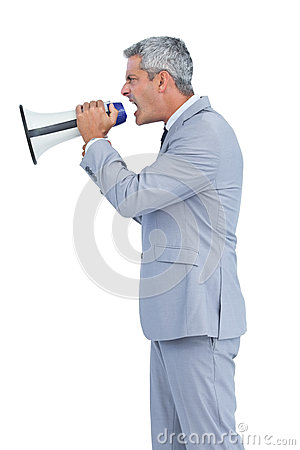 Furious businessman shouting in loudspeaker