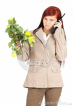 Furious calling young woman with flowers