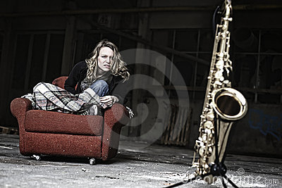 Furious girl starring at saxophone