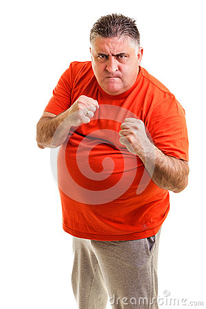 Furious man clenching his fists ready to fight
