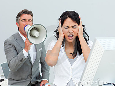 Furious manager shouting through a megaphone