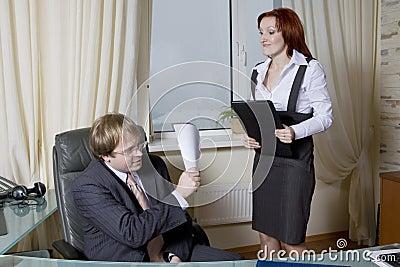 Furious secretary going to beat boss.