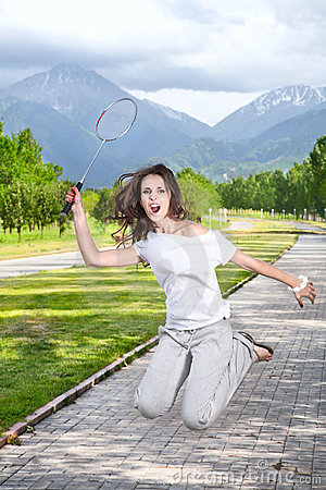 Furious Woman playing badminton
