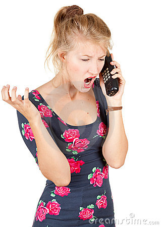 Furious woman speaks by a mobile phone