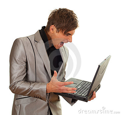 Furious young man keeping laptop