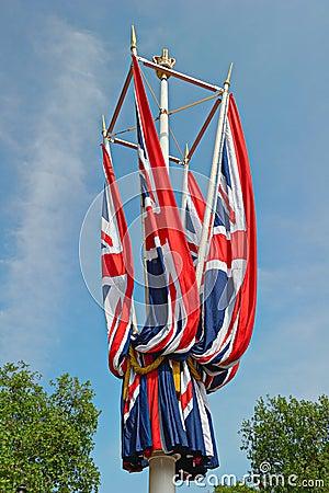 Furled Union Jack flags London, England, UK