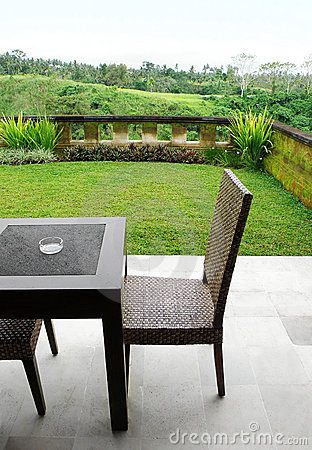 Furniture on landscaped patio with view