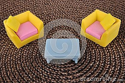 Furniture toy on brown grass intertexture