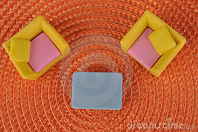 Furniture toy on orange grass intertexture