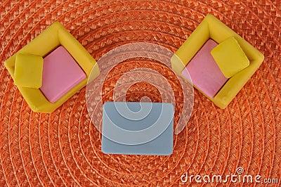 Furniture toy on orange grass intertexture
