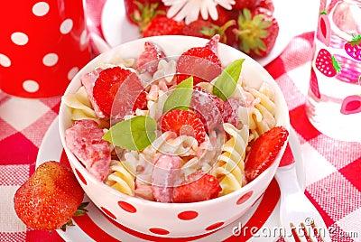 Fusilli pasta with strawberry for child