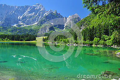 Crystal clear Fusine lake, Alpine scenery. Friuli, Italy