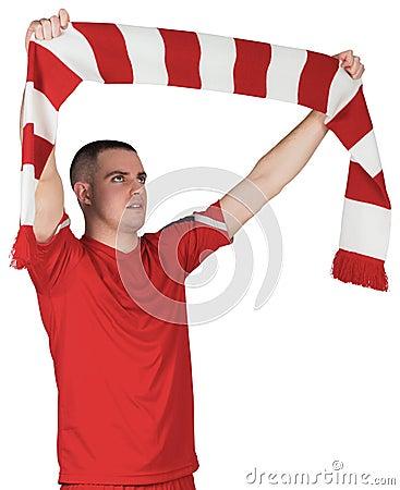 Futbolista que celebra la bufanda rayada
