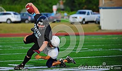 Futebol americano da juventude o equipamento Foto de Stock Editorial