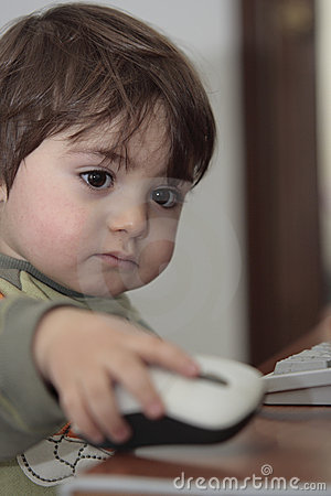 Boy with computer mouse