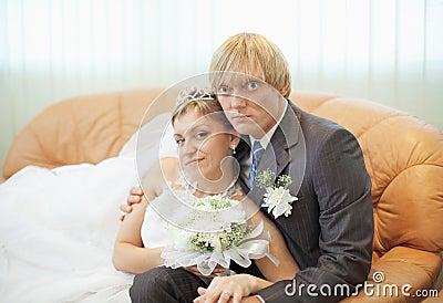Future husband and wife on leather sofa