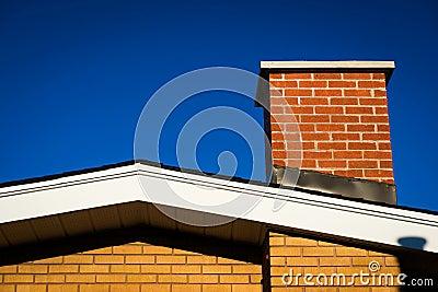 Gable of Brick House With Brick Chimney
