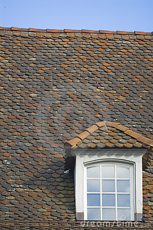 Gabled window on tiled roof