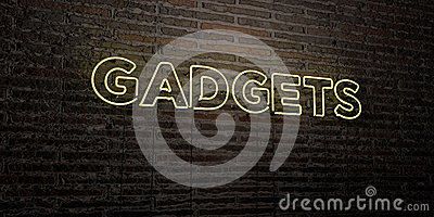 GADGETS -Realistic Neon Sign on Brick Wall background - 3D rendered royalty free stock image Stock Photo