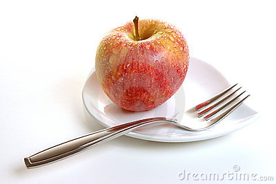 Gala apple on saucer