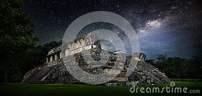 Galactic night starry sky over the ancient Mayan city of Palenqu