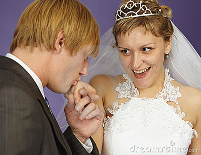 Gallant groom kisses hand