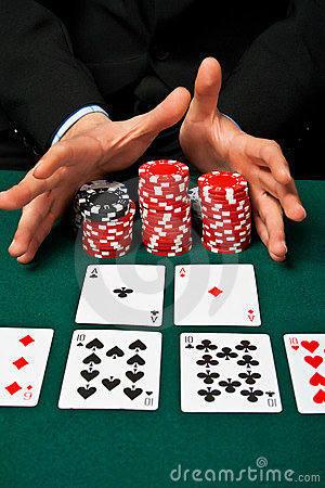 Gambler with cards and chips.