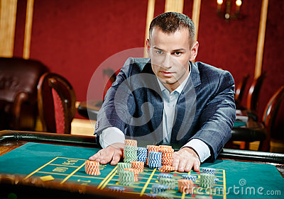 Gambler placing a bet at the roulette table