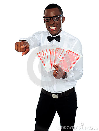 Gambler with playing cards pointing at you