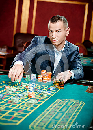 Gambler playing roulette at the casino