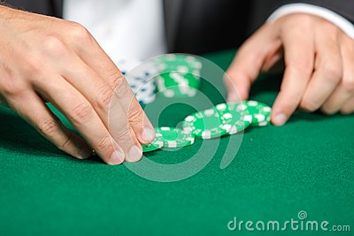 Gambler puts the chips on the table
